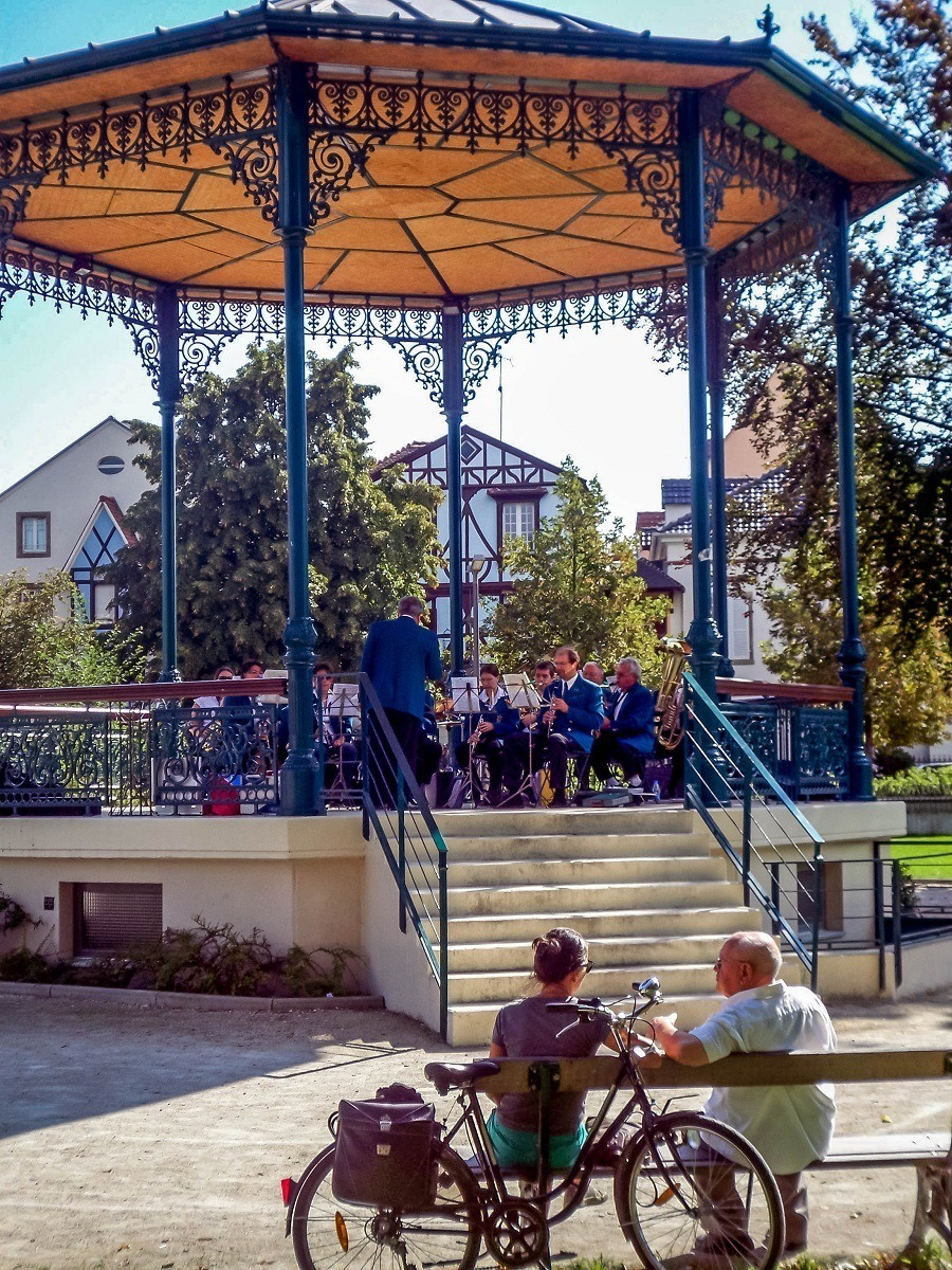 A band playing music in the band stand in Colmar, France