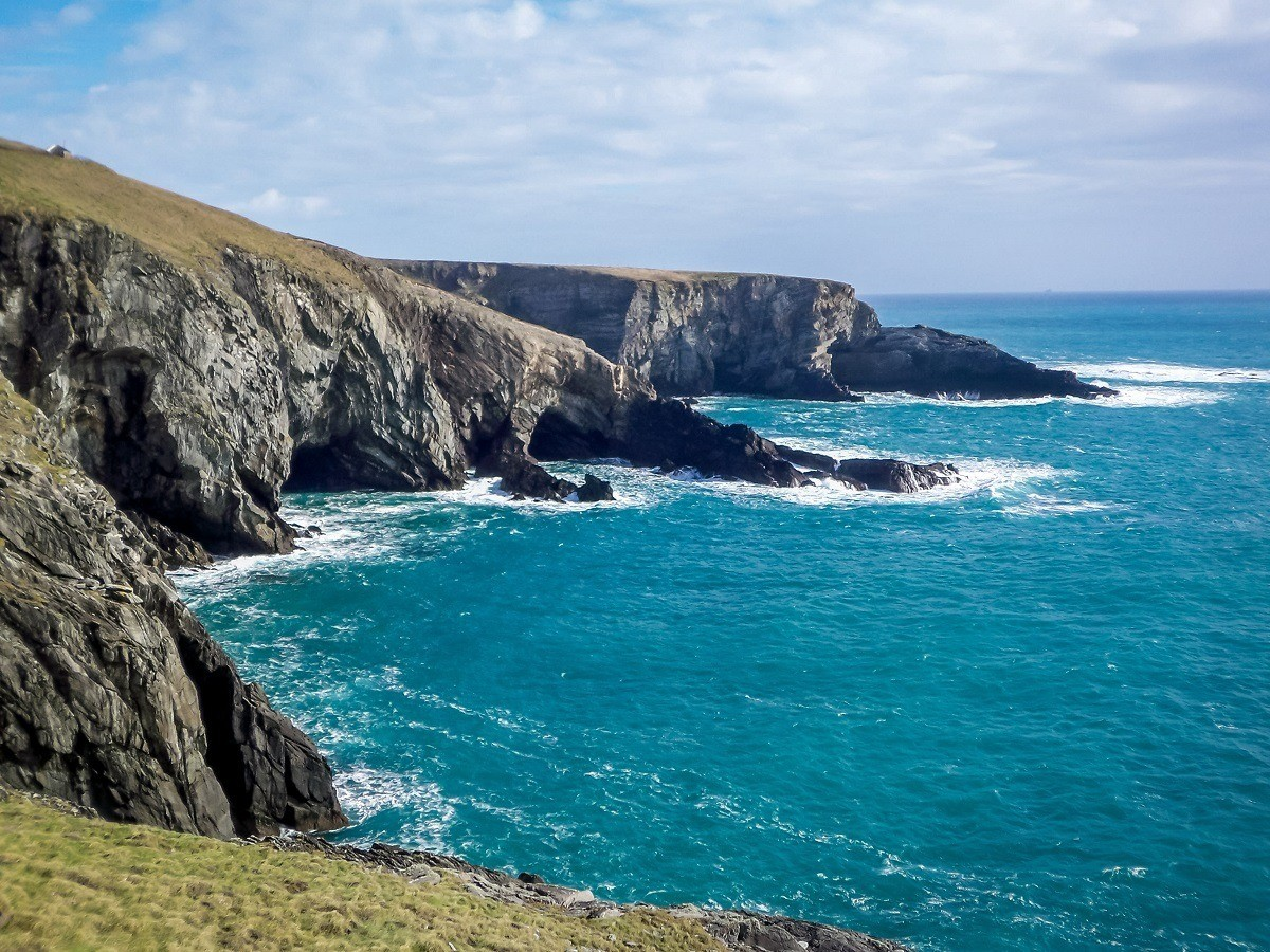 Bed Breakfast Ireland tips:  Smaller towns can get you closer to attractions and save you money.  Cliffs meeting the blue water of the Atlantic Ocean at Mizen Head, in County Cork, near Kinsale. You don't need to participate in the voucher country schemes bed and breakfast options, you can book your own B&Bs and save money.