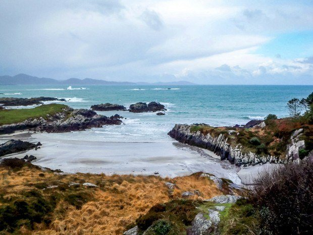 The colorful coastline of Ireland's Ring of Kerry on an overcast day. We explore two of the country's famous drives -- what's better -- Dingle Peninsula or Ring of Kerry?