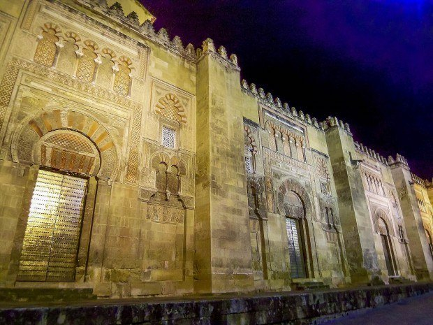 The facade of La Mezquita Cordoba at night.