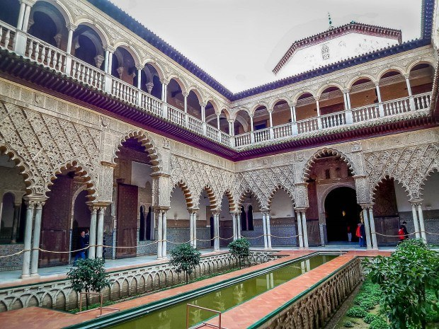 The courtyard of the Seville Alcazar palace in Spain.