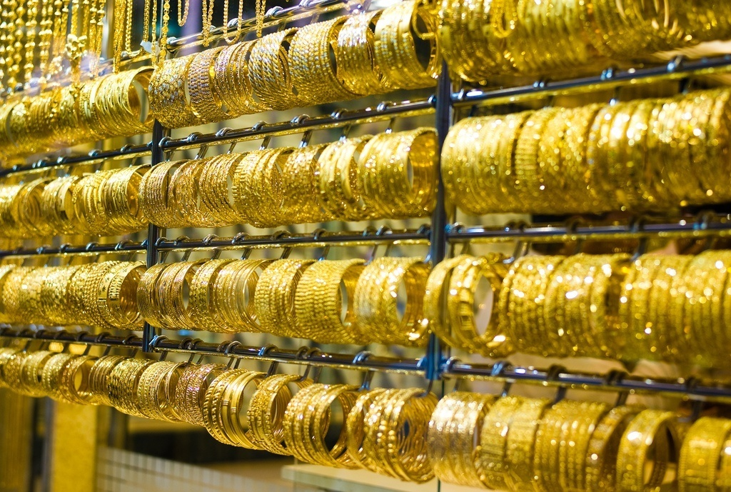 Rows of gold bracelets in jewelry store