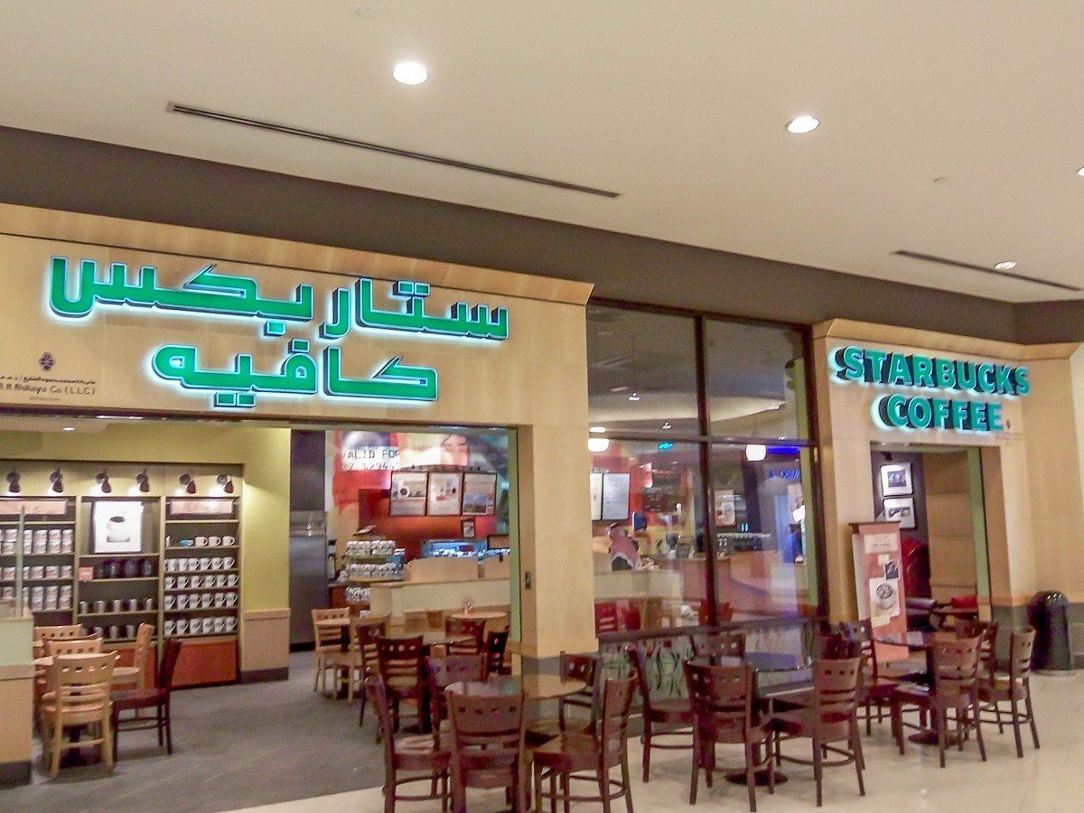 In the malls in Dubai, many stores have signage in both Arabic and English.