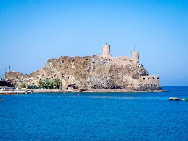 The Al Mirani Fort guarding the Muttrah harbor in Muscat, Oman. Visiting the forts is one of the top things to do in Oman.