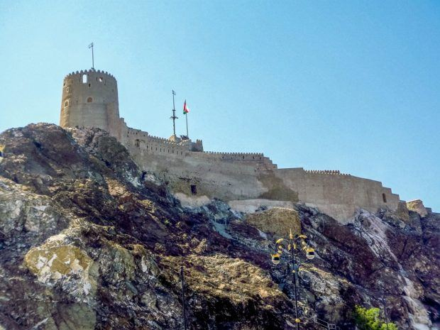 The Muttrah Fort towers above the harbor. If you're wondering what to do in Oman, visiting a fort is probably near the top of the list.