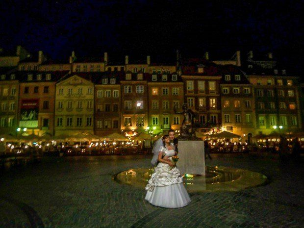 A couple having wedding photos taken in Warsaw's Old Town.