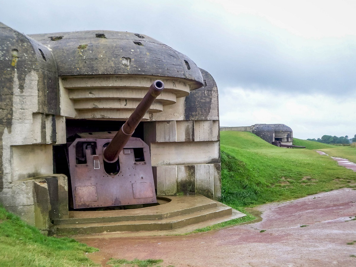 The German guns at the Longues sur Mer battery above the D Day beaches of Normandy. The Battlefields of World War 2 are some of the most popular attractions in France.