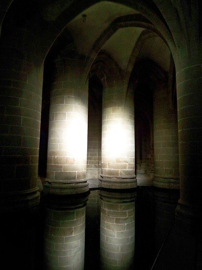 The Abbey at Mont Saint-Michel illuminated at night.