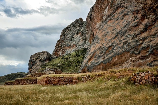 Ruins at the base of a rock in Pukara, Peru