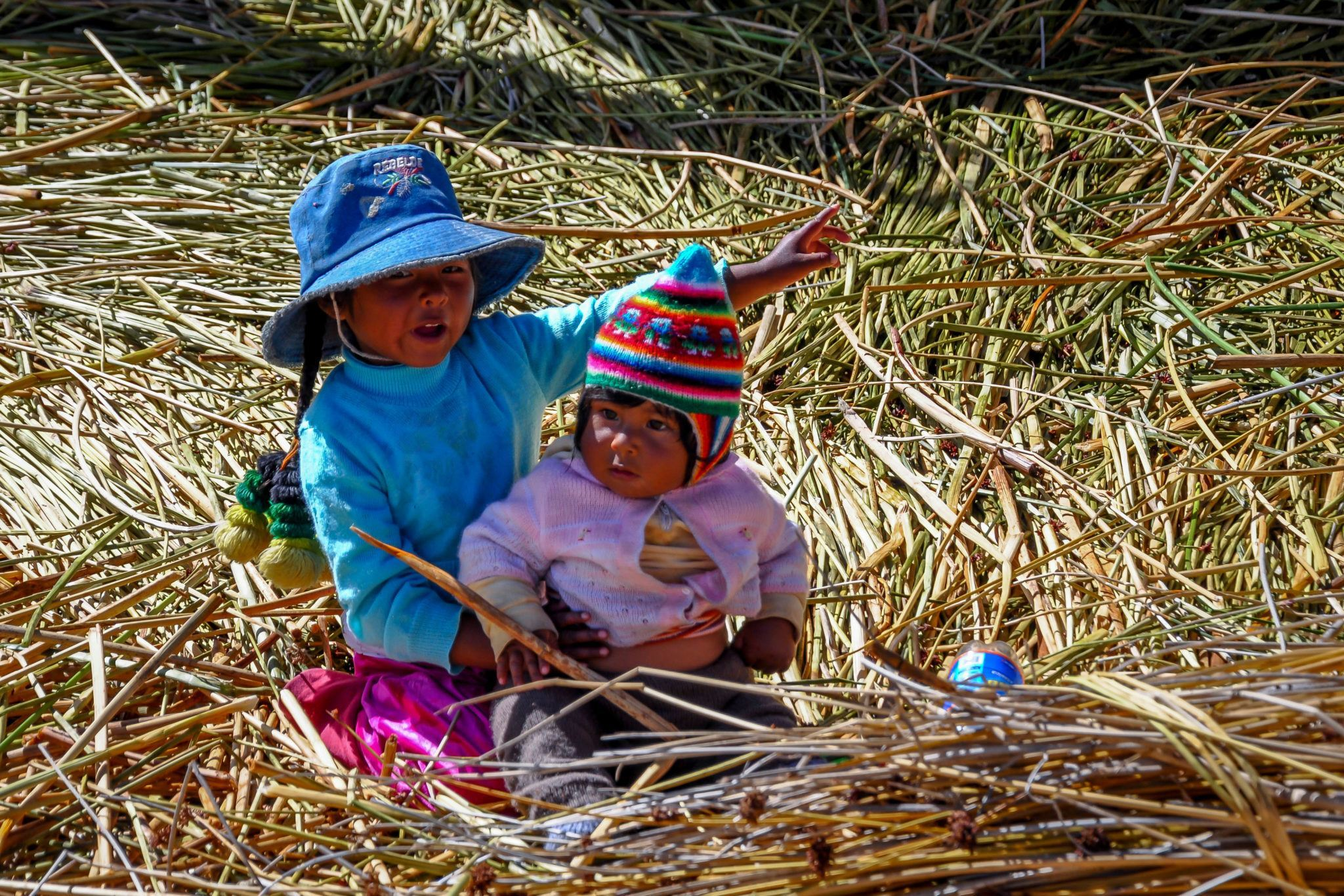 Kids playing on the Uros Islands in Lake Titicaca