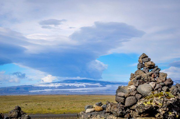 Road trip Iceland photos:  We encountered this stone pile or cairn along Iceland's southern coast.  For our trip we planned an Iceland Ring Road itinerary 10 days adventure.  And it was awesome!