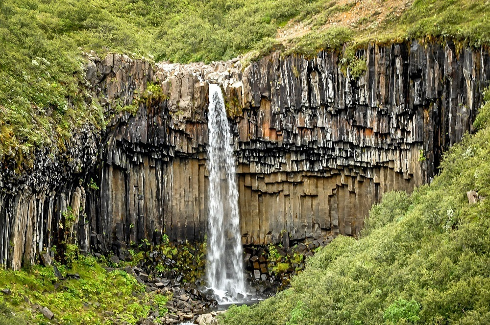 Hiking the waterfalls in Iceland, like Svartifoss