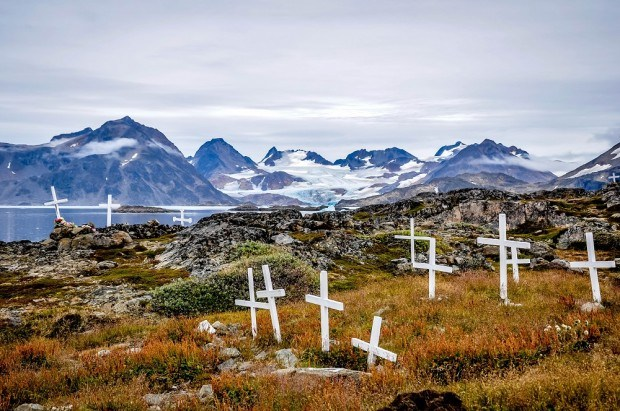 Crosses mark the Kulusuk, Greenland cemetery.  This was the first stop on our Air Iceland Connect Greenland tour from Iceland. Greenland tourism is about enjoying nature and the basics of a simple culture. Greenland travel is more basic than a lot of other places in the world - don't expect luxury here.