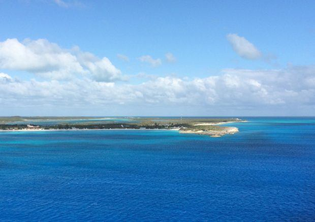Little San Salvador Island in the Bahamas is a cay:  a low-evaluation sandy island on top of a coral structure.  The island is owned by Carnival Cruise Lines.