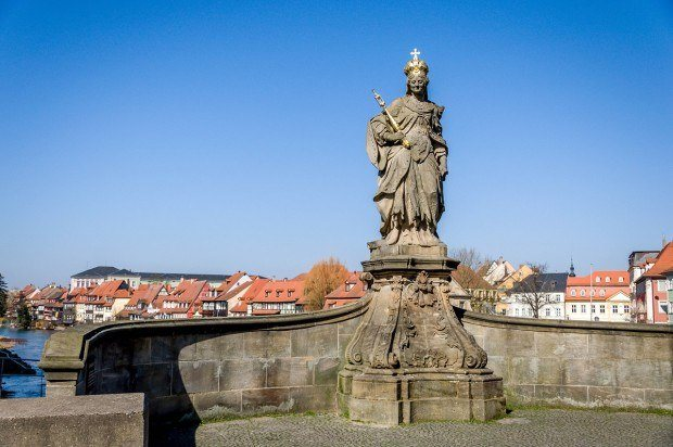 The Queen Kunigunda Statue on the Alte Rathaus bridge in Bamberg, Germany.