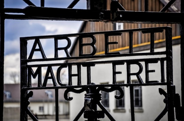 "Front gate of Dachau concentration camp saying ""Arbeit Macht Frei"" -- ""Work makes you free:"