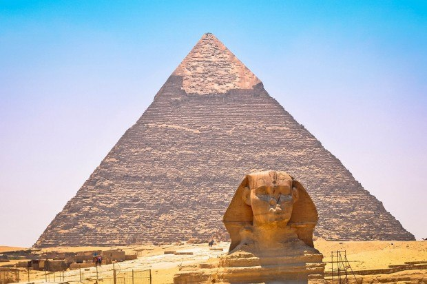 The Great Sphinx of Giza along with the Great Pyramid of Giza. Seeing these two incredible structures is the highlight of any Egypt pyramids tour to Giza near Cairo.