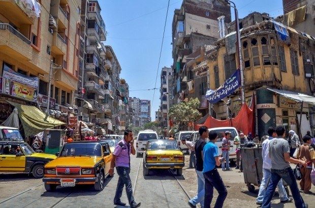 Streets of Alexandria Egypt filled with cars and people