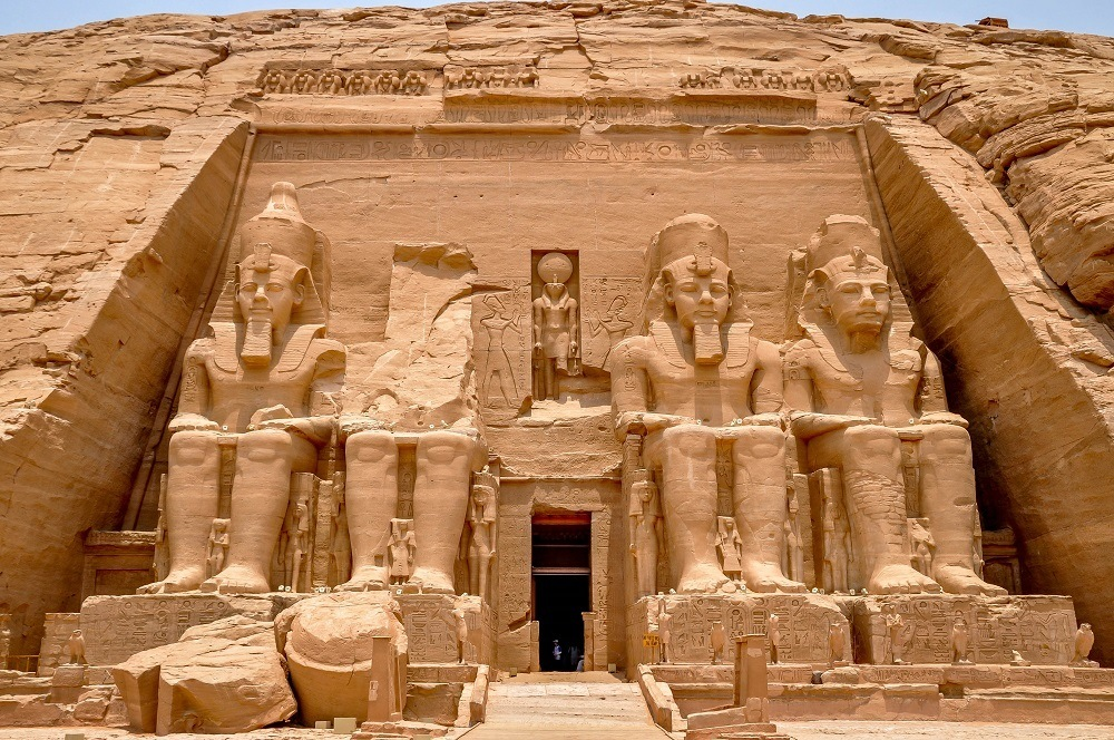 Four giant carvings of a pharaoh out of rock at Abu Simbel in Egypt