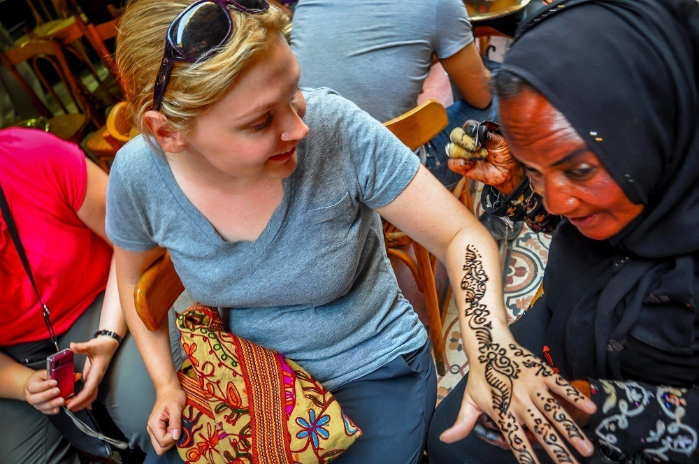 Getting a henna tattoo in Khan al-Khalili