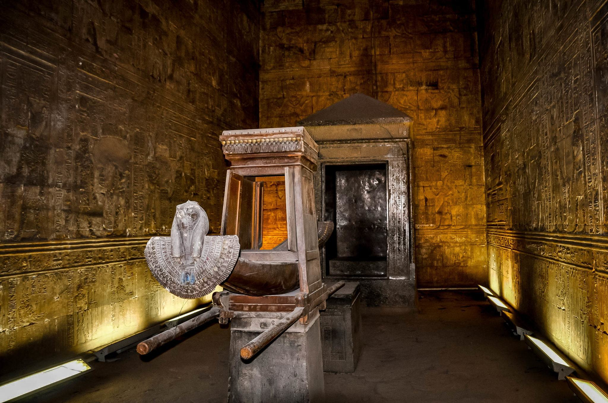 An offering to the god Horus:  the funeral boat at Edfu temple in Egypt. The sanctuary is full of Horus images and is an extremely impressive sight to see.  The Horus ancient Egypt carvings are remarkably preserved.