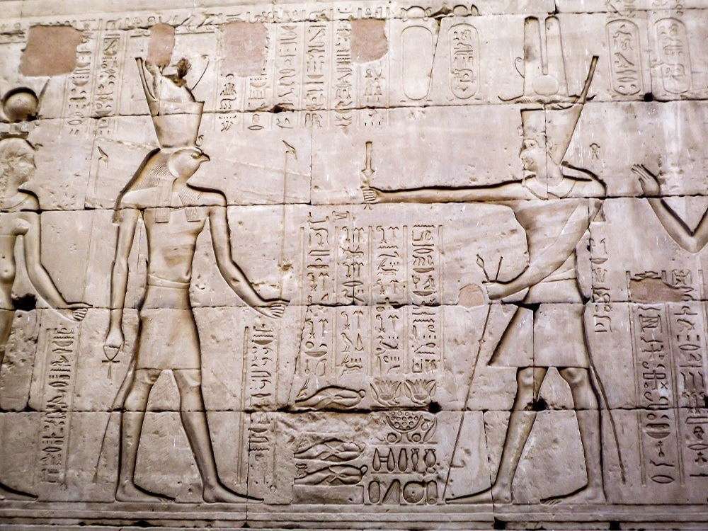 Horus pictures: Reliefs of the pharoahs in the Edfu temple in Egypt. The Egyptian Horus god is easily recognized because of his falcon head.