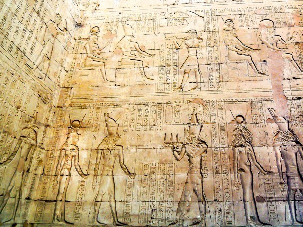 Carvings and reliefs in the Edfu temple in Egypt. The Temple of Edfu inscriptions can still be clearly seen over 1800 years later.