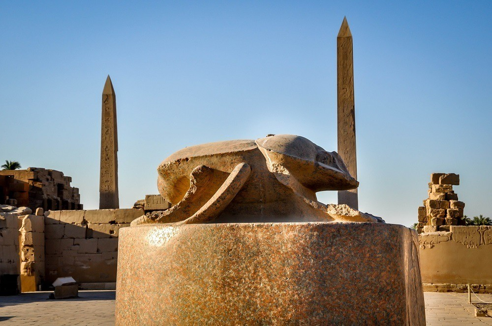 Scarab statue in Karnak Temple with obelisks