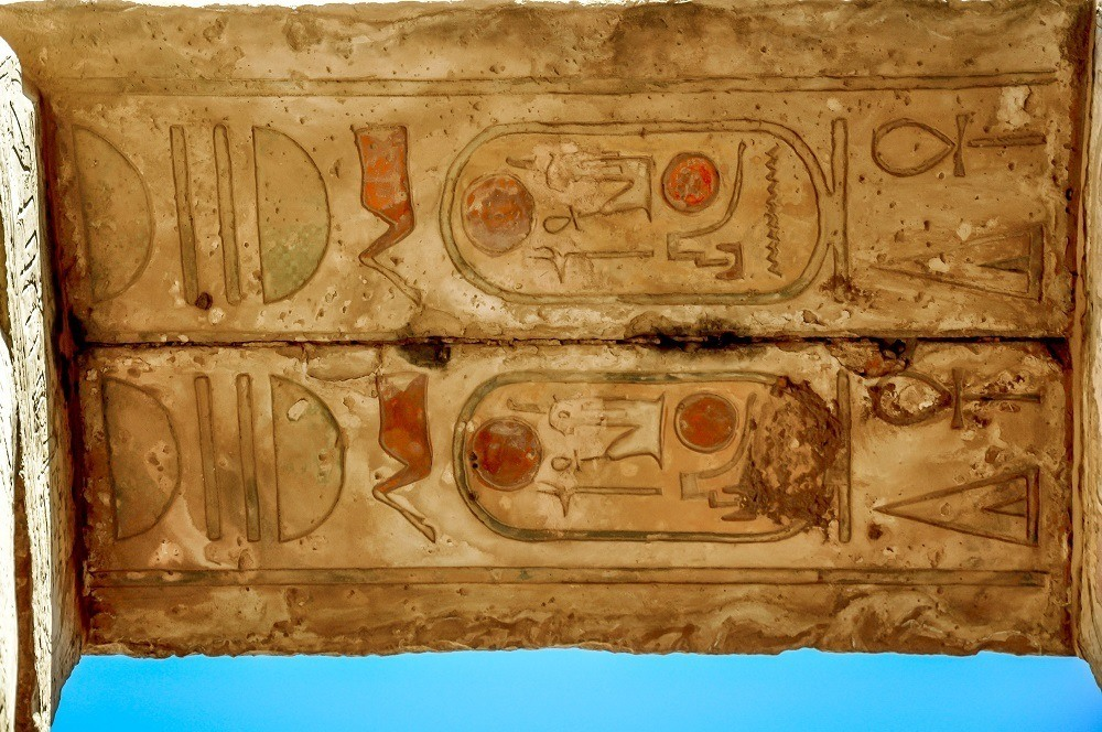 Colored cartouches on the underside of an arch at Karnak Temple