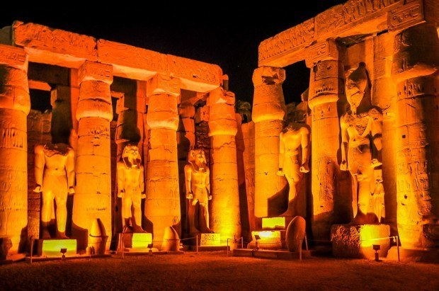 Pharaoh statues at Luxor Temple lit up at night