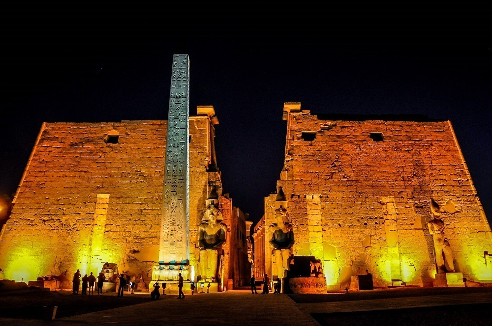 Luxor Temple and obelisk lit up at night