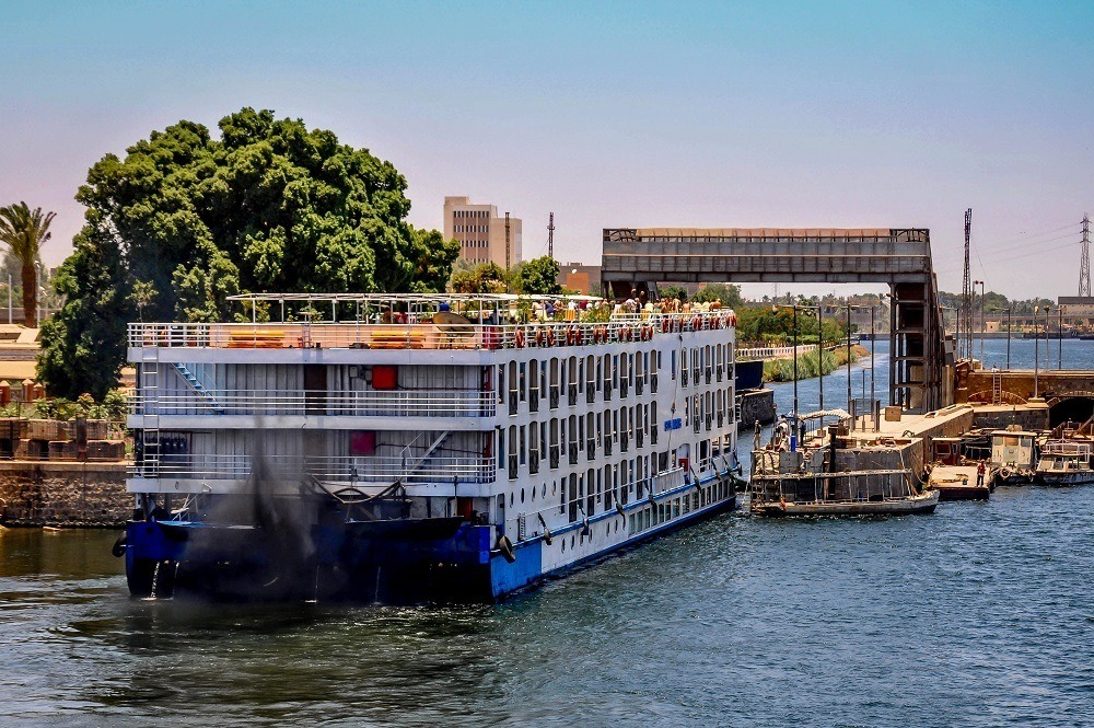 Cruise boat passing through locks on the Nile