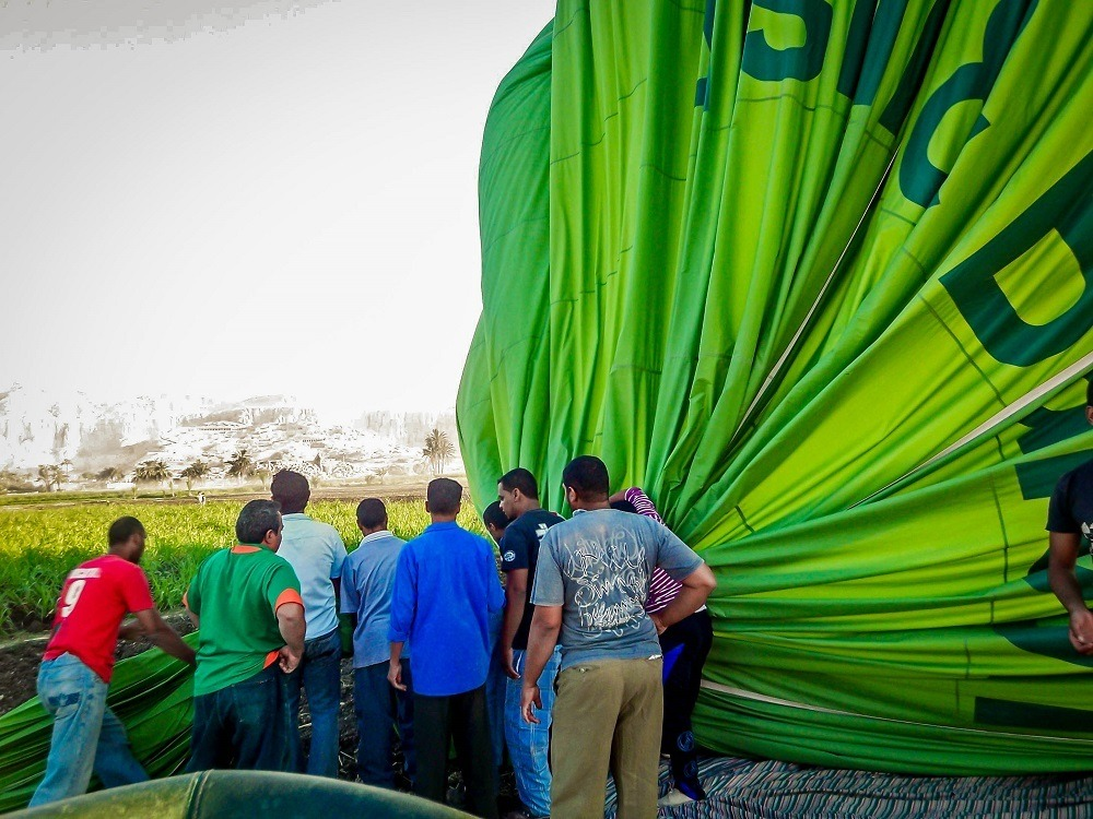 Crew deflating a hot air balloon