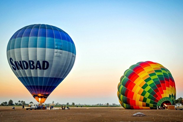 Egypt hot air balloon being inflated in the early morning