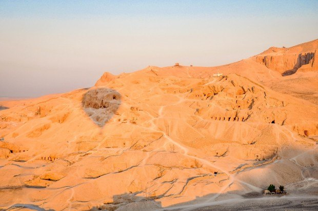 Shadow of a hot air balloon against the Egyptian valley