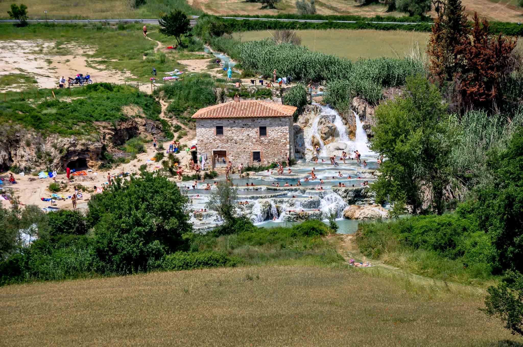 Wide angle view of the Saturnia hot springs complex. Called locally Saturnio Italia and sometimes mis-spelled Saturina Thermal Springs, this hot spring Tuscany style is an amazing place of beauty and relaxation.
