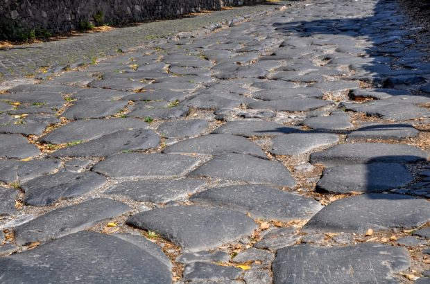 The rough cobblestones of the Appian Way Rome.