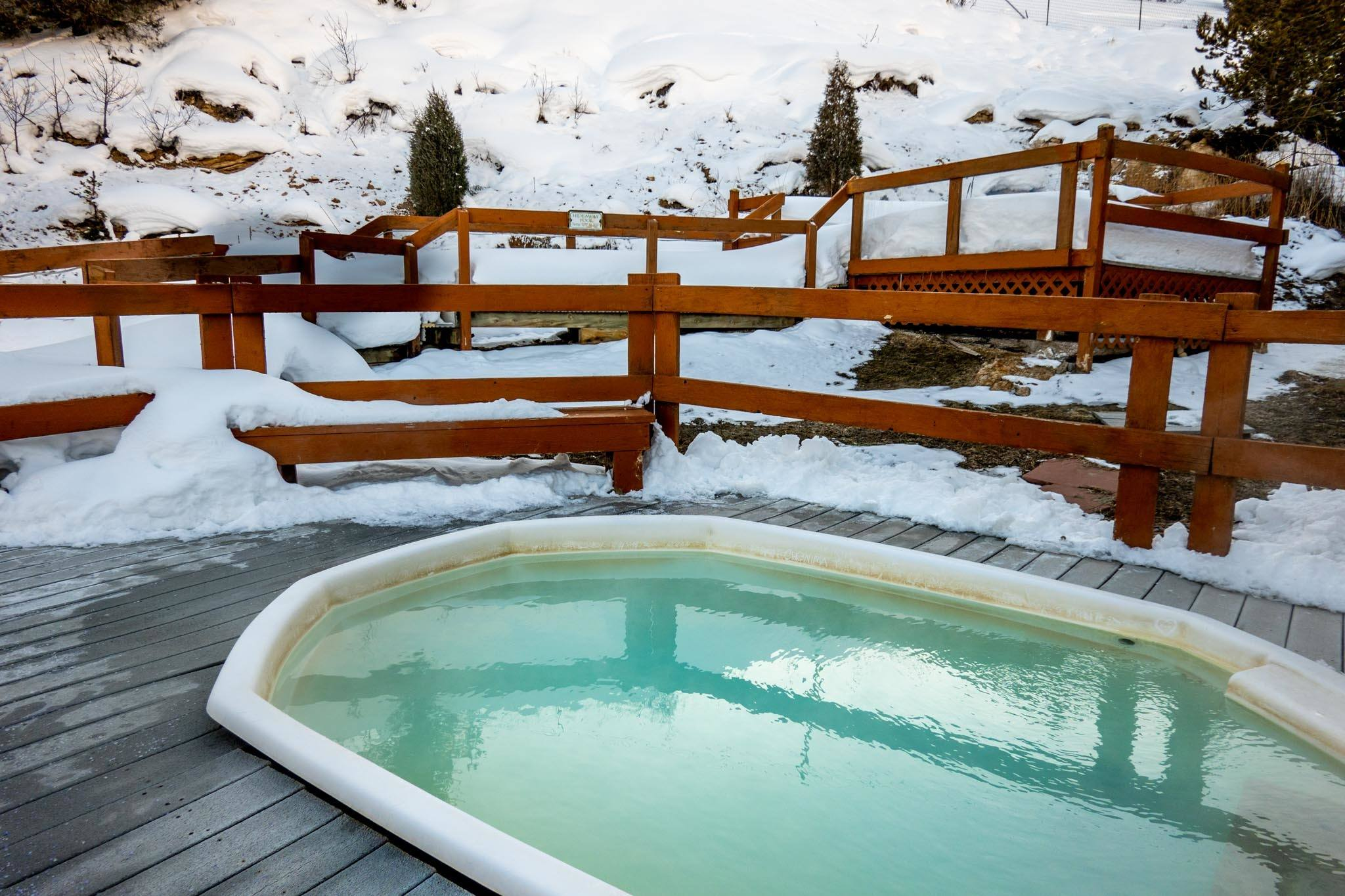 The Hot Sulphur Springs pools in winter with snow.