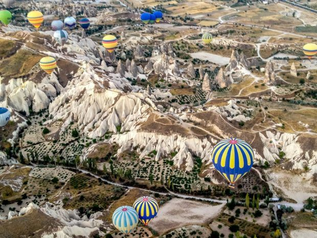Hot air balloons over the valleys of Goreme, Turkey.