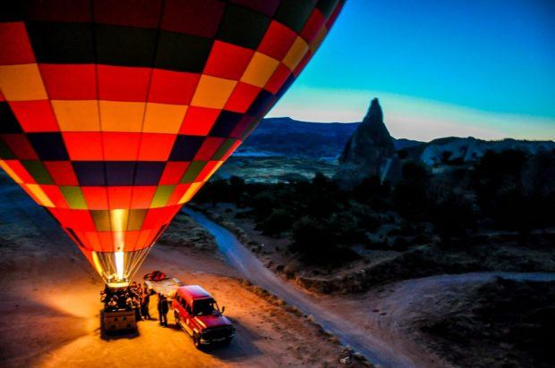 Hot air balloons in Cappadocia inflating in the early morning hours.