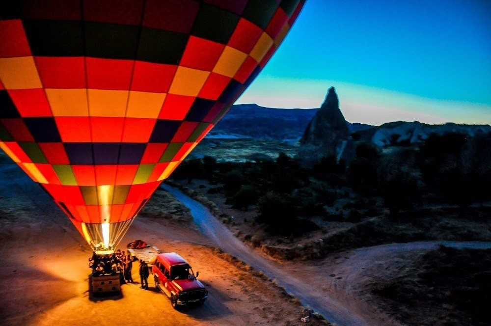 A burner inflating one of the hot air balloons in Cappadocia in the early morning hours