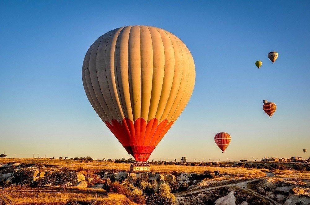 Hot air balloons landing in a field