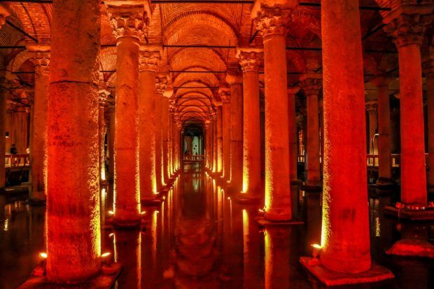 The illuminated columns of the underground world of the Basilica Cistern in Istanbul.