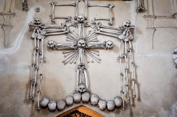 Cross sculpture made of bones