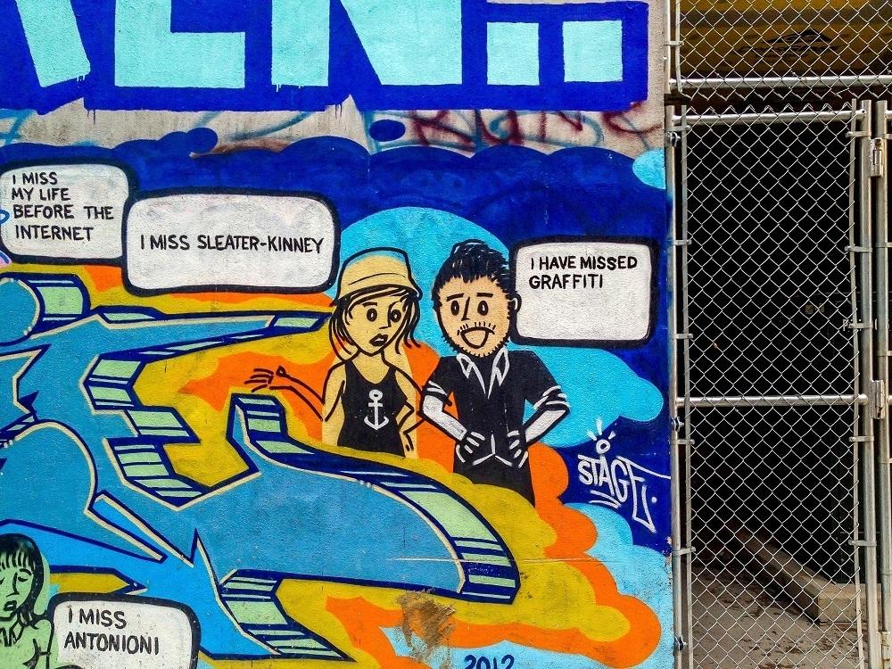 Hipster street art in Graffiti Alley Toronto
