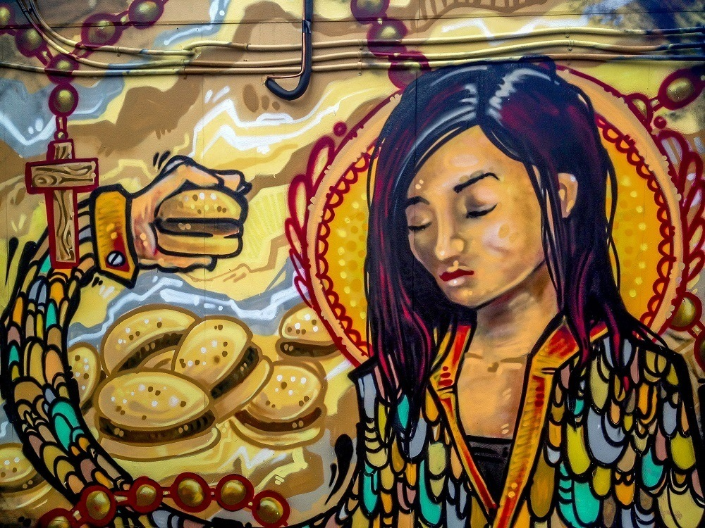 Girl with hamburger street art in Graffiti Alley Toronto