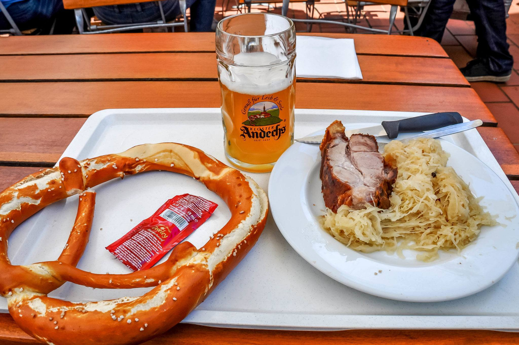 Pretzel, beer, sauerkraut, and pork lunch at Andechs monastery
