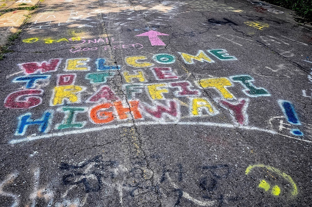 Spray painted graffiti saying Welcome to the Graffiti Highway