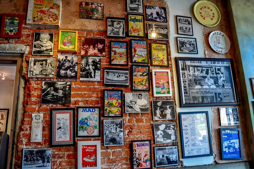 Framed pizza memorabilia on wall at Philly's Pizza Brain