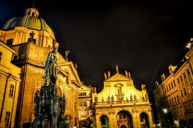 Prague architecture by night -- Church of St. Francis of Assisi, Church of the Savior and statue of Charles IV